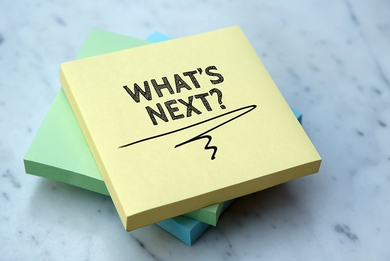 "Image of a post-it note with the text ""What's Next?"" written on it"