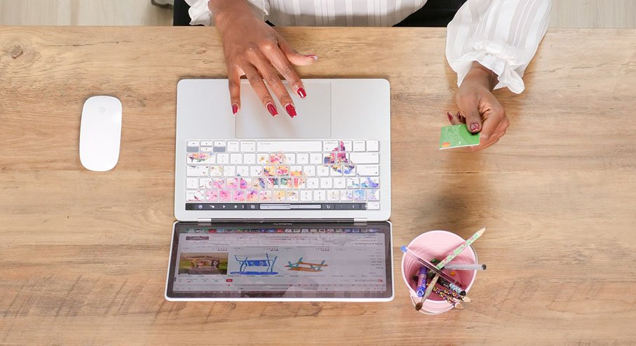 Photo of a lady using laptop to make an online purchase.