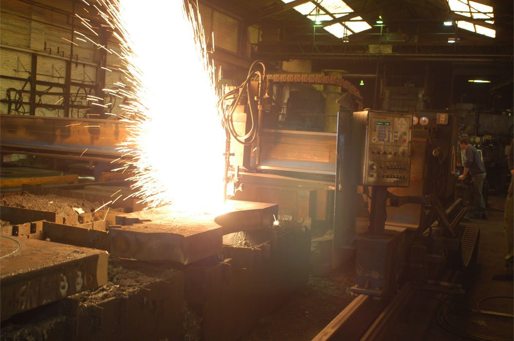 Cutting metal at Malthouse Engineering Factory.